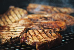 Steaks on barbecue Royalty Free Stock Images