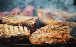 Steaks on barbecue Stock Photos