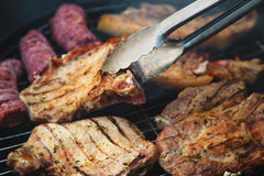 Steaks on barbecue Royalty Free Stock Photography