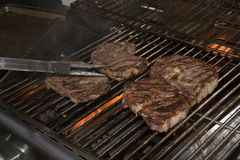 Steaks on a barbecue grill Stock Photography