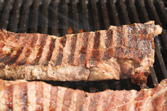 Steaks being grilled Stock Image