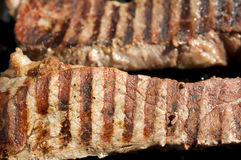 Steaks being grilled Royalty Free Stock Photography