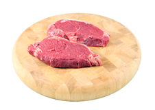 Steaks on a chopping board Royalty Free Stock Photo