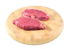 Steaks on a chopping board. Tenderized Steak on a chopping board on a white background Royalty Free Stock Photo