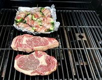 Steaks cooking on a Gas Grill Royalty Free Stock Image
