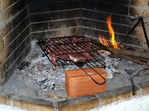 Steaks Cooking on Open Fire Royalty Free Stock Images