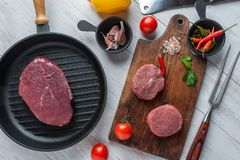 Steaks on cutting board royalty free stock images