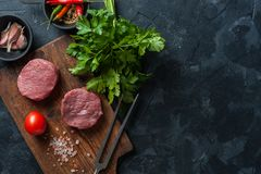 Steaks on cutting board royalty free stock image
