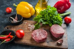 Steaks on cutting board royalty free stock photography