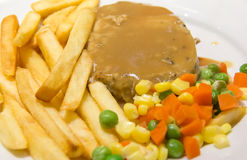 Steaks and French fries Royalty Free Stock Photography