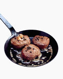 Steaks in frying pan Stock Photo
