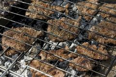 Steaks on grill. Steak on campfire. Steak food concept. Steak ready for eating royalty free stock photography