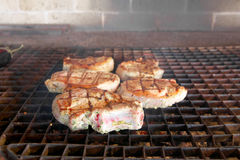 Steaks on the grill Stock Photos