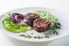 Steaks with lettuce. Steak with lettuce, rosemary and mashed potatoes stock photos