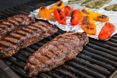 Steaks and peppers on the grill Stock Photos