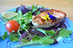 Steaks from red fish with lemon and sauce. Two pieces of fresh red fish with lemon and soy sauce Stock Image