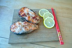 Steaks from red fish with lemon and sauce. Two pieces of fresh red fish with lemon and soy sauce Stock Photos