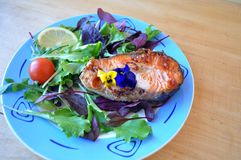 Steaks from red fish with lemon and sauce. Two pieces of fresh red fish with lemon and soy sauce Stock Photography