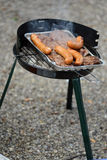 Steaks and sausages on grill Royalty Free Stock Photography