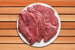 Steaks serving table Royalty Free Stock Photo