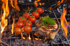 Steaks and tomato BBQ Stock Photography