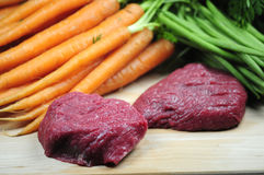 Steaks and vegetables. Some fresh steaks and vegetables stock image