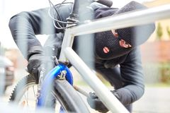 Steal bicycle thief on a bicycle. Bicycle thief on bicycle steal in the city royalty free stock images