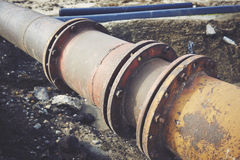 Steal big pipeline on a ground. Old pipes joint. Stock Images