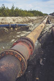 Steal big pipeline on a ground. Old pipes joint. Royalty Free Stock Photos