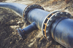 Steal big pipeline on a ground. Old pipes joint. Royalty Free Stock Photo