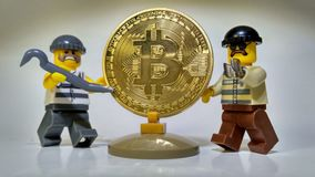 Steal Golden Bitcoin money robbery. Hackers Steal Bitcoins money robbery Royalty Free Stock Photography