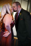 Steal a Smooch. A sassy loving couple who are spontaneously kissing each other. Shallow depth of field Royalty Free Stock Images
