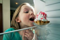 Stealing the cake from fridge royalty free stock photography