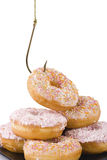 Stealing a doughnut Royalty Free Stock Image