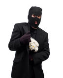 Stealing Flowers. A thief wearing a black suit and a balaclava is stealing a bouquet of daisies Stock Images
