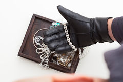 Stealing jewellery stock photos