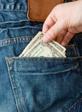Stealing money from back pocket Royalty Free Stock Photo