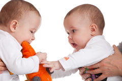 Stealing toys Royalty Free Stock Images