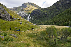 Steall Falls and tourists royalty free stock photo