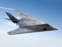 Stealth aircraft. Streaking through the sky with afterburners and vapor trails Stock Photo