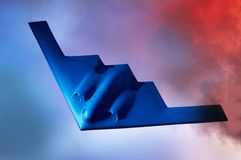 Stealth B-2 Bomber. Oncoming Stealth B-2 Bomber shot against a blue orange sky with room for copy Royalty Free Stock Images