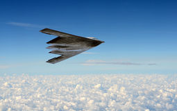 Stealth bomber in flight. Modern stealth bomber flying at high altitude Stock Photos