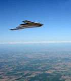 Stealth bomber in flight. State of the art stealth bomber flying at high altitude Royalty Free Stock Photos