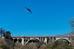 B2 Stealth Bomber flyover Colorado Street Bridge in Pasadena, California. The stealth called Spirit of New York finishing a flyover of Rose Bowl stadium on New royalty free stock image