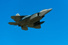Stealth fighter. In flight, blue sky stock image