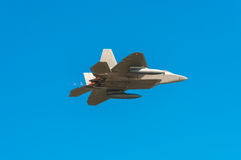 Stealth fighter. In flight, blue sky stock photos