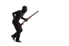 Stealthy criminal with a mask and a rifle walking. Isolated on white background Stock Images