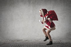 A  stealthy Santa Claus. Running away Royalty Free Stock Images