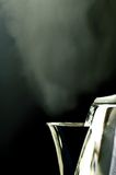 Steam. Chrome Steaming kettle against black background Royalty Free Stock Photography