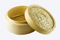 Dim sum steam basket. Traditional dim sum steam basket with a half opened lid, isolated on a white background royalty free stock images
